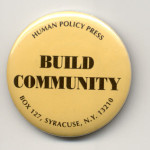 "Yellow pin-button with a that reads ""Build Community"" and the Human Policy Press address in black"